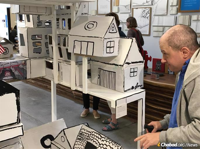 Artist Kevin Shink with his large three-dimensional creation depicting the city of Detroit