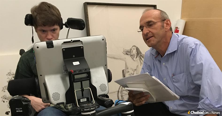 "Artist Felicia Bowers being interviewed by writer Howard Blas at the Dresner Soul Studio. Bowers has cerebral palsy, is non-verbal, uses a wheelchair at all times, and communicates—and draws—with assistive technology. Her drawing in the background, ""The Dancer,"" which depicts a very active dancer in a wheelchair, recently sold for $14,500."