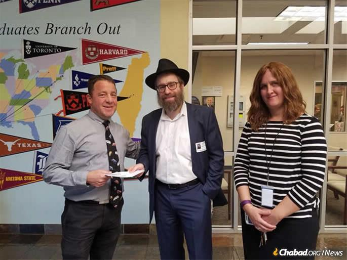#ChabadHarveyRelief earmarked funds a year ago to assist families with children at Houston-area day schools who are struggling post-storm. In coordination with the Jewish Family Service of Houston, grants of $500 were made to 65 children at the Robert M. Beren Academy, one of the receiving academic institutions. From left are: Dr. Paul Oberman, head of school at Beren Academy; Rabbi Chaim Lazaroff of Chabad Harvey Relief in Houston; and Gitty Francis, MSW, special project coordinator for JFS.