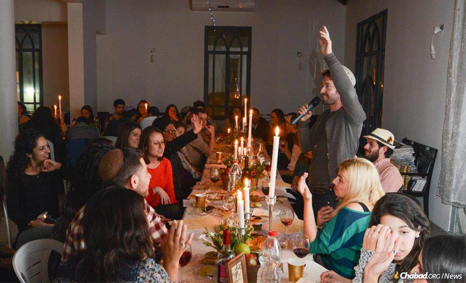 Food and socializing are a big part of Jewish life in Tel Aviv, like at this midweek event at Chabad of the Coast, above. (Photo: avinoophotography)