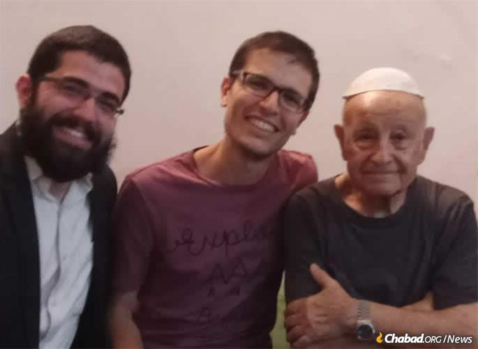 The rabbi and Fitoussi with another visitor.