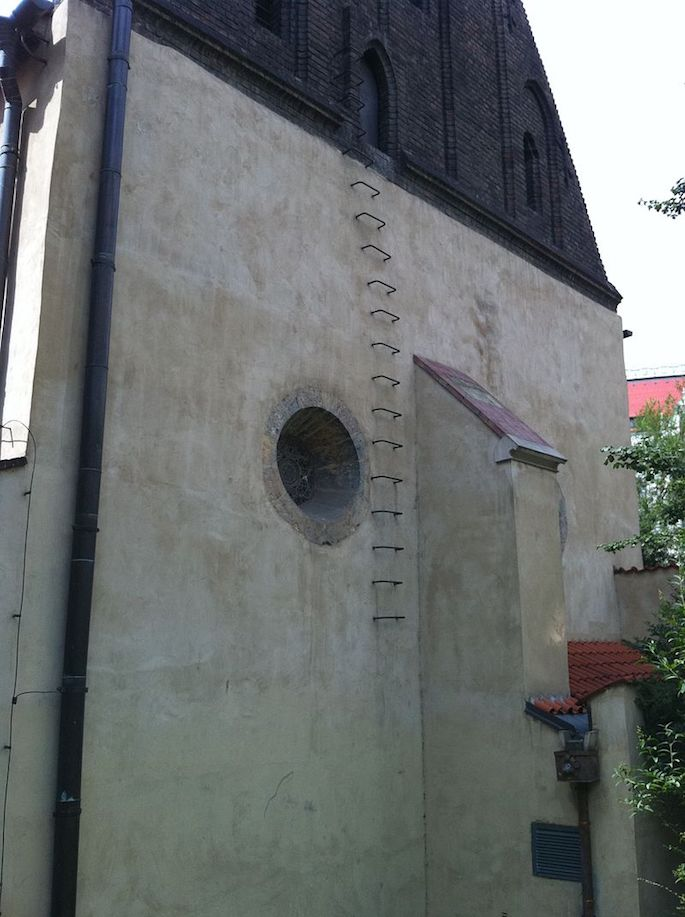 Rear of the Old New Synagogue in Prague, showing rungs leading to the attic where the remains of the Golem are said to have been stored. (Photo: Wikimedia)