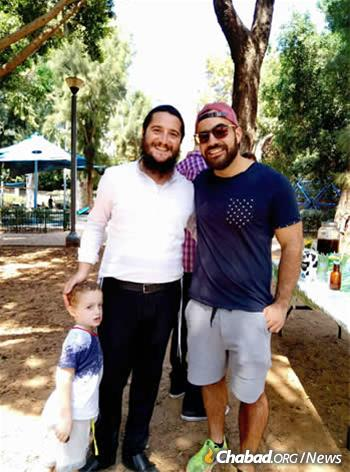 Rabbi Eli Naiditch, left, with Dudu Asaraf, a 26-year-old recent immigrant from South Africa who has hosted two Shabbat meals as part of the First Friday program.