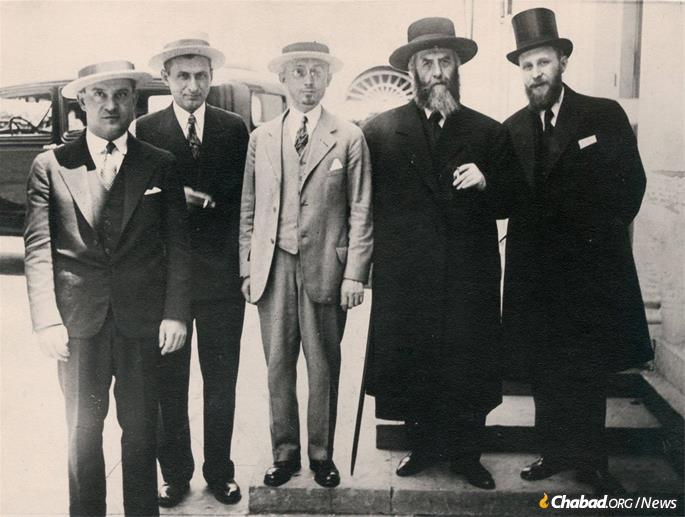 Hyman Kramer, center, next to Rabbi Yosef Yitzchak Schneersohn, the sixth Rebbe, and Rabbi Shmaryahu Gurary, right