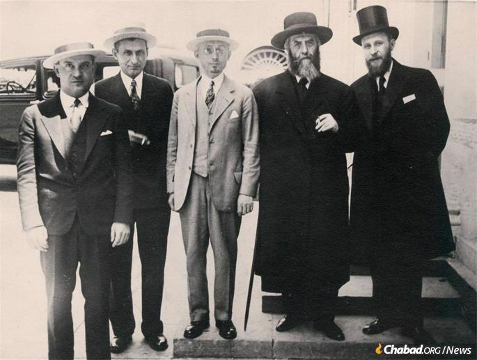 Hyman Kramer, center, next to Rabbi Yosef Yitzchak Schneersohn, the sixth Rebbe, and Rabbi Shmaryahu Gurary, right