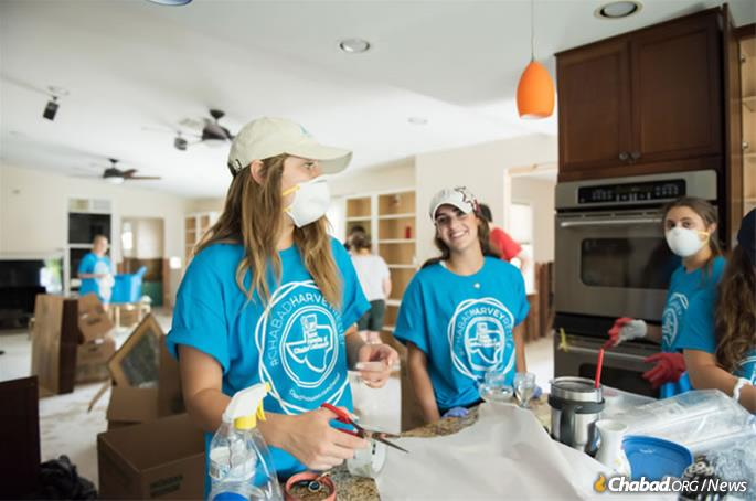 Student volunteers from college campuses as far away as Boulder, Colo., arrived en masse in Texas to spend their Labor Day weekend pitching in, like these women cleaning up the kitchen in a family home in Houston. (Photo: Elisheva Golani)