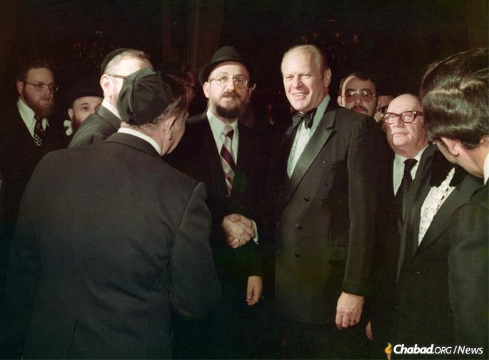 In 1976, Fogelman became the first chairman of the newly founded Community Board 9, established to ensure that the Jews who remained in Crown Heights would have their voices heard. He is seen here with President Gerald Ford, who lost his re-election campaign to Jimmy Carter that same year. (Photo: Fogelman family collection)