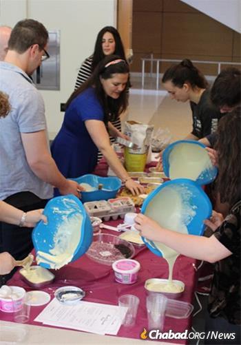 Students, residents, staff and community members enjoy a doughnut-making workshop last Chanukah.