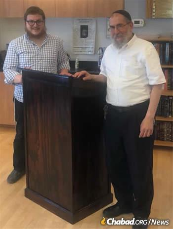 A lectern crafted by an inmate named Aaron was donated to Chabad and F.R.E.E. of Niles, where Rabbi Binyomin Scheiman, right, serves as director.