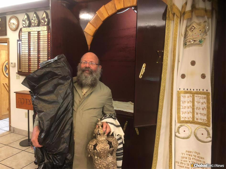 Rabbi Doron Aizenman evacuates Torah scrolls from the Myrtle Beach Chabad synagogue.