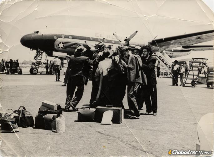 Dancing at the tarmac in Israel, July 13, 1956. Fogelman is second from right. (Photo: Fogelman family collection)