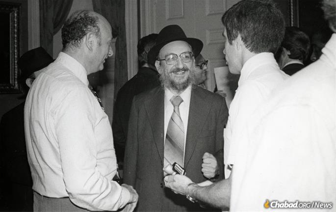 """Our spiritual leader, Rabbi Menachem Schneerson, said 10 years ago we must worry not only about our personal selves but about our community,"" Fogelman told the ""New York Daily News"" in 1976. ""If richer people leave, the poor and the elderly remain behind. This is not right. We have decided to stay."" He is seen here with Mayor Ed Koch. (Photo: Fogelman family collection)"