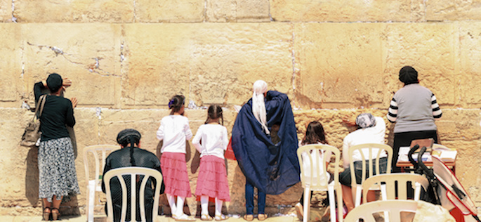 Jewish women praying at the Kotel, otherwise known as the Western or Wailing Wall. The Kotel is adjacent to the Temple Mount in Jerusalem, Judaism's holiest site.