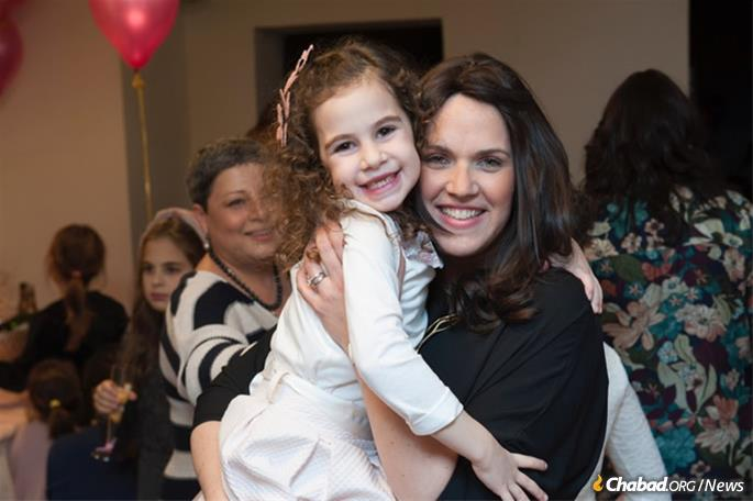 Fruma Ita Wolff and daughter Sara at a bat mitzvah celebration in the pre-renovated Chabad center.