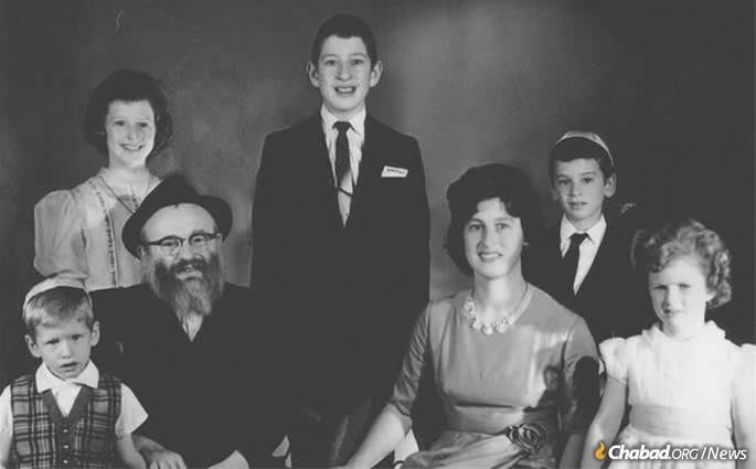 Rebbetzin Chaya Zelda (Clara) Kramer with her husband, Rabbi Leib Kramer, and family at the bar mitzvah of their son, Michel, center.