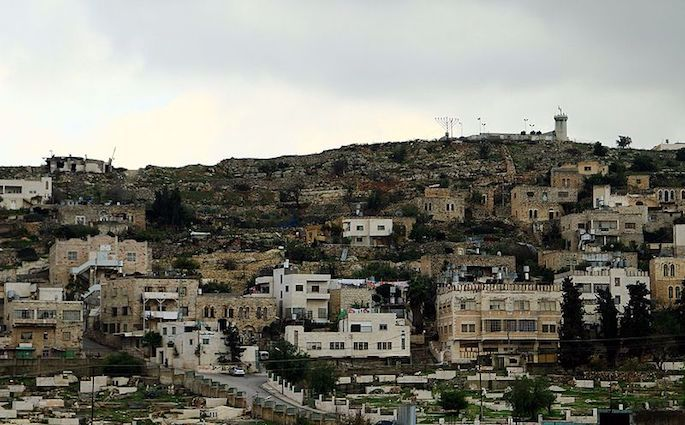 A menorah proudly displayed on a hill in Hebron. (Photo: Wikimedia)