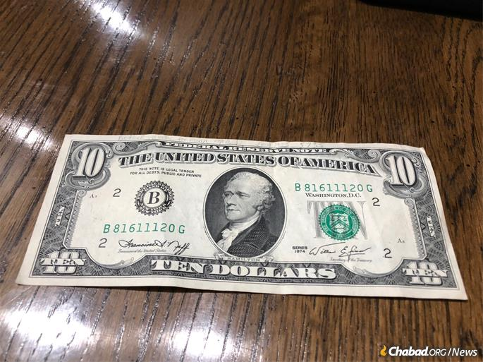 Rivka Saks of Pittsburgh received this $10 bill from the Rebbe 44 years ago and has treasured it ever since. Hoping to broaden the reach of the project, she has pledged to give the bill to whomever steps forward to make a contribution of at least $10,000 to the effort.
