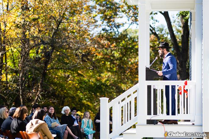 Rabbi Moshe Gray addresses celebrants at the new center, which sits on a two-acre plot with a large garden for hosting outdoor events, such as kosher barbecues and the annual bonfire for Lag BaOmer. (Photo: Chabad of Dartmouth)