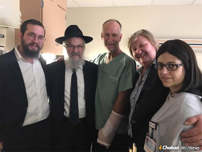 From left: Rabbi Henoch Rosenfeld, Rabbi Yisroel Rosenfeld, Officer Dan Mead, Diane Mead (Dan's sister) and Dr. Mylynda B Massart