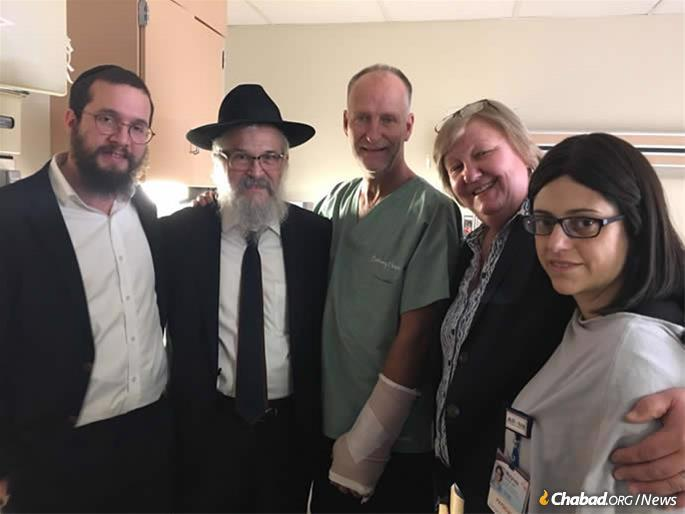 From left: Rabbi Henoch Rosenfeld, Rabbi Yisroel Rosenfeld, Officer Dan Mead, Diane Mead (Dan's sister) and Dr. Mylynda B Massart