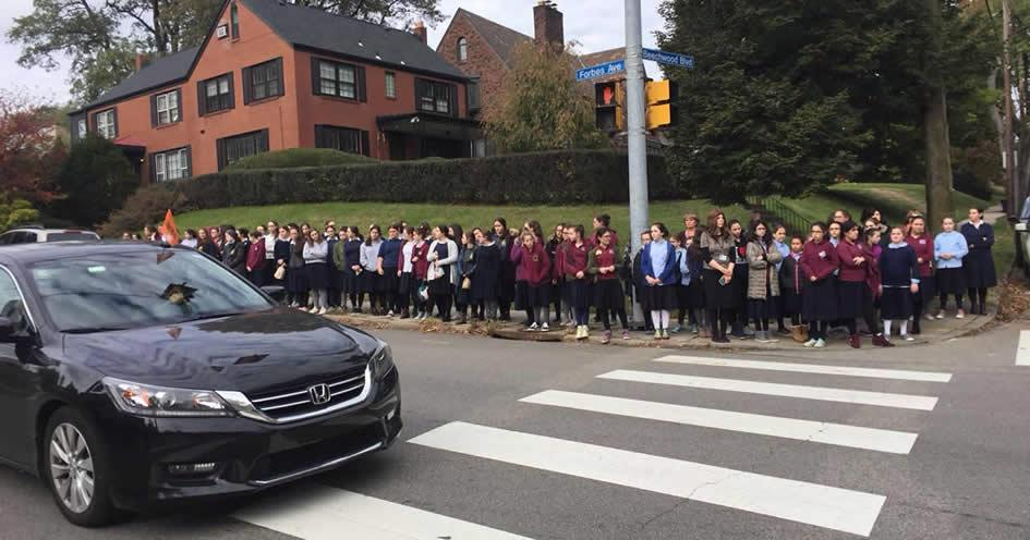 Students of Yeshiva Schools of Pittsburgh pay their respects as the funeral procession of Dr. Jerry Rabinowitz passes through Squirrel Hill.