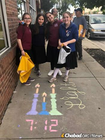 Girls at the Yeshiva have been spending extra time reaching out to their community in response, including joining the #LetsChalkShabbat project.