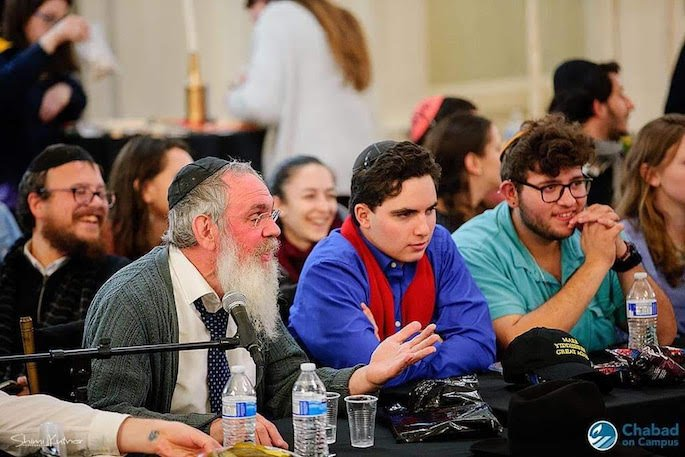 Rabbi Shmuel Posner, Shliach to Boston University, with students. (Photo: Chabad on Campus)