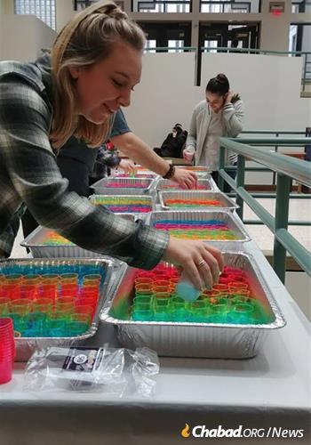 Preparing Shabbat candles for hundreds of women for the Chabad at Pitt Friday-night dinner.
