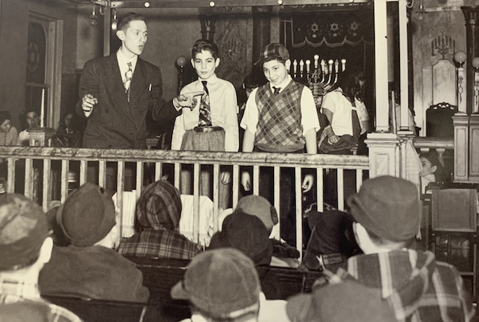 Chabad Rabbi Jacob J. Hecht addresses a group of Jewish schoolchildren in Brooklyn, New York, in the mid-1940s.