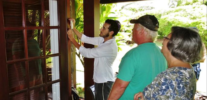 Helping a family affix a Mezuzah in Kauai, Hawaii.