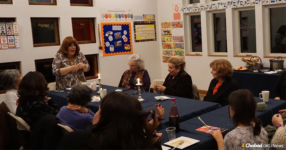 """Rivka Hurwitz shares her thoughts on """"The Kabbalah of Knitting"""" during a post-Shabbat talk at the Chabad Dutchess-Rhinebeck Jewish Center."""