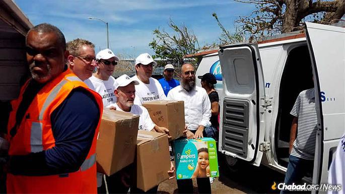 Rabbi Mendel Zarchi, center, helped coordinate the airlift and delivery of food after Hurricane Maria.