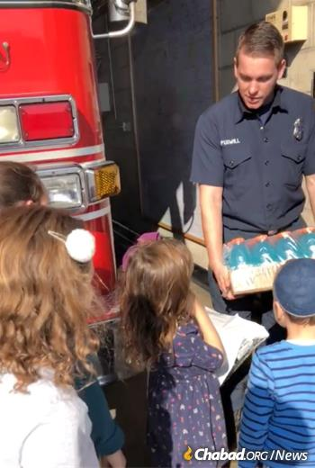 The Simons family brings drinks and food to firefighters.
