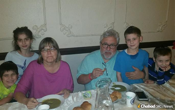 Randy and Lois Stein with the Zweibels. They have lost their home and their business, but not their hope.