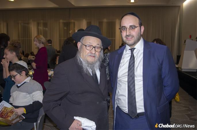 Rabbi Moshe Feller, center, with Rabbi Yonatan Ghermezian