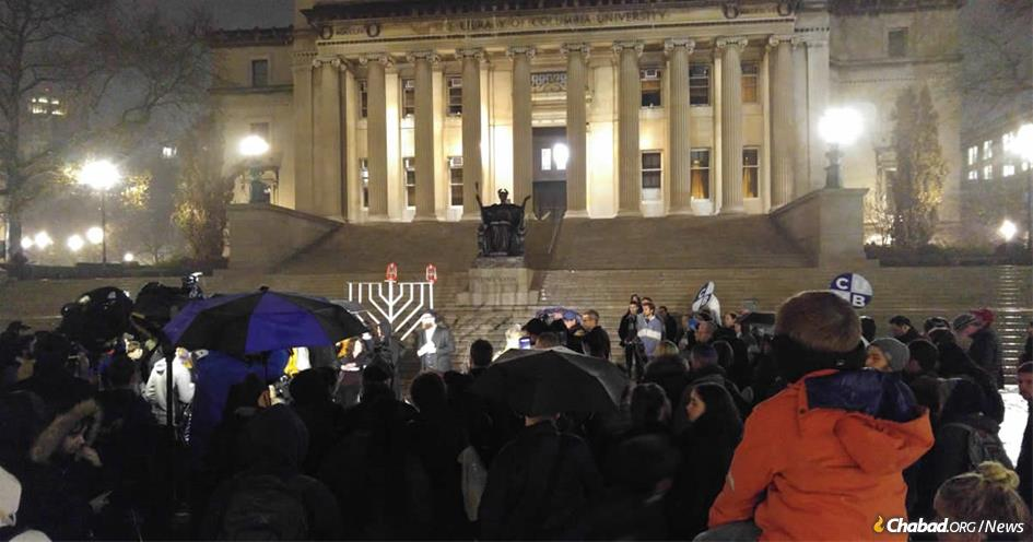 Professor Elizabeth Midlarsky, a psychology and education scholar whose office was vandalized with anti-Semitic images last week, lit the first candle of the Columbia University campus menorah in front of the famed Low Library.