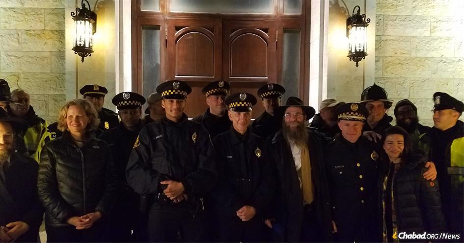 Eleven Pittsburgh police officers, who were among the first responders to the Oct. 27 mass shooting that claimed 11 Jewish lives in a Squirrel Hill synagogue, helped light the menorah at Chabad of Roslyn on Long Island, N.Y.