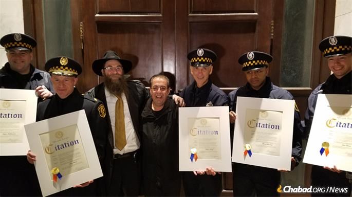 Rabbi Aaron Konikov, director of Chabad of Roslyn, with the officers.