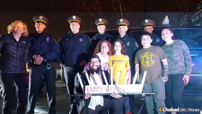 Neighborhood residents mingled with local officials and law-enforcement authorities, who also attended the lighting.