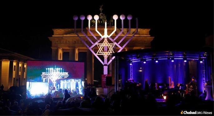 German President Frank-Walter Steinmeier lit the shamash (helper) candle on a menorah erected at the Brandenburg Gate, a site where the Nazis vowed to destroy Judaism.