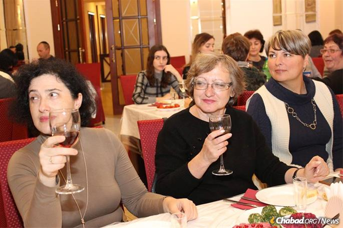 Women celebrate Yud-Tes Kislev.