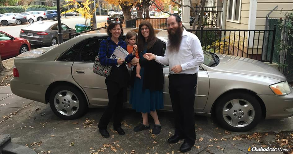Rabbi Mendy and Chana Zwiebel (right and second from right), co-directors of Chabad of Chico, Calif., have launched a program to provide used cars in sound working condition to victims of the Camp Fire with a demonstrated need for transportation.