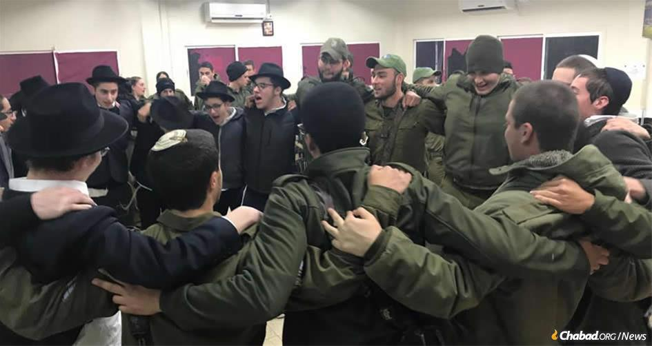Yeshivah students from Safed dance with IDF troops in Metulla prior to an operation in which the troops destroyed a 40-meter-long-tunnel built by the Iranian-backed terror group Hezbollah. The tunnel started in the Lebanese town of Kfarkela and snaked its way into Metulla, an Israeli town of 1,000 surrounded on three sides by Lebanon.