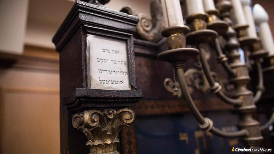 Dedication plaques on antique furniture tell the story of generations of devoted congregants who supported Anshei Lubavitch through the centuries. (Photo: Brett Walkow)