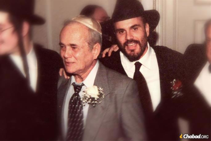 A photo of me and my father at my wedding in 2001.