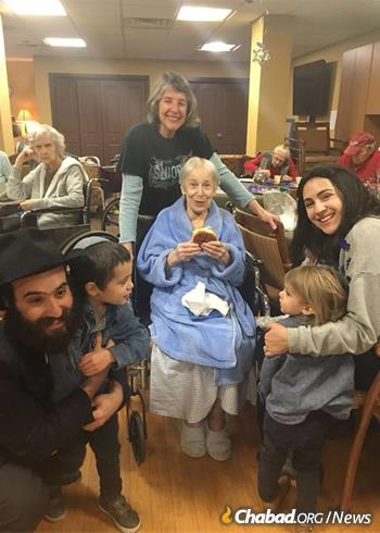 Draizy Junik, right, the Raskins' daughter, moved back with her husband, Rabbi Eliyahu Junik, left, in 2014 to co-direct programs at Chabad of Vermont. In addition to work with seniors, above, they focus on young professionals and families.