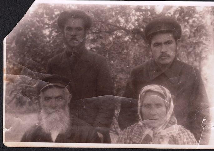 Bottom: Grandfather Mendel Hillel Gansburg, his wife Sarah, and his sons Yankel and Yitzchak Gansburg.
