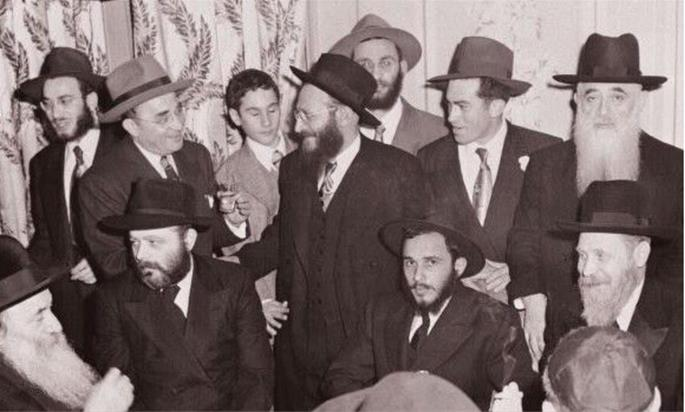 (Ramash, sitting second from the left, at the wedding Rabbi Zalman and Mrs. Risya Posner in 1949.)