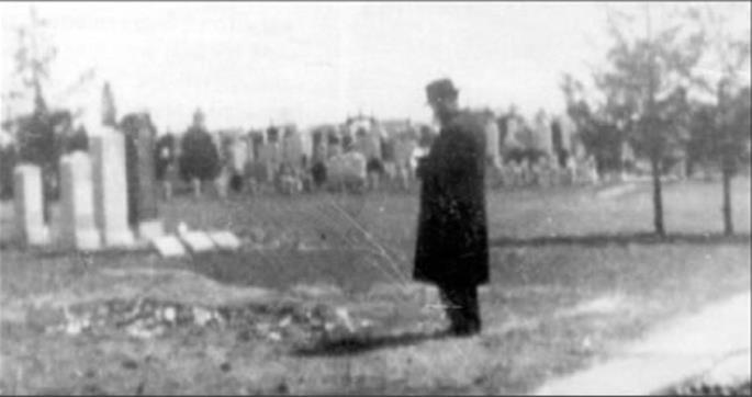 (Ramash at the resting place of his father-in-law, Rabbi Yosef Yitzchak, in the summer of 5710 (1950).)