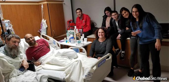 Simon, Levitz and members of Levitz's family gather at the hospital two days after the surgery.